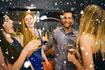Composite image of laughing friends drinking beers