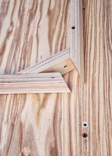 Table corner of plywood, veneer and solid ash in workshop