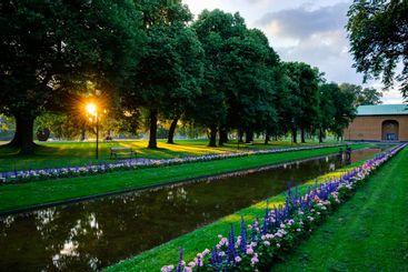 Sunlit canal in city park, Karlstad, Värmland, Sweden,...