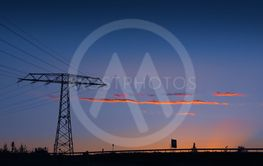 Electricity pylon and power lines at sunset