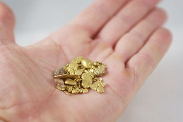 Handful Of Gold Nuggets
