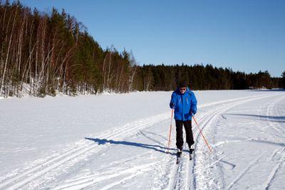 male skier on white snow in sunshine
