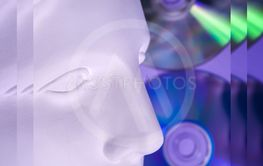 Antique statue of Venus head close up on a glitter CDs...