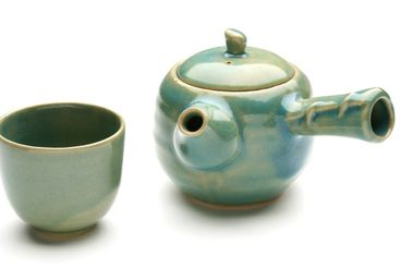 Antique chinese teapot and a tea cup