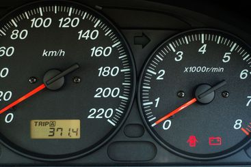 Car dashboard with speed and rpm dials