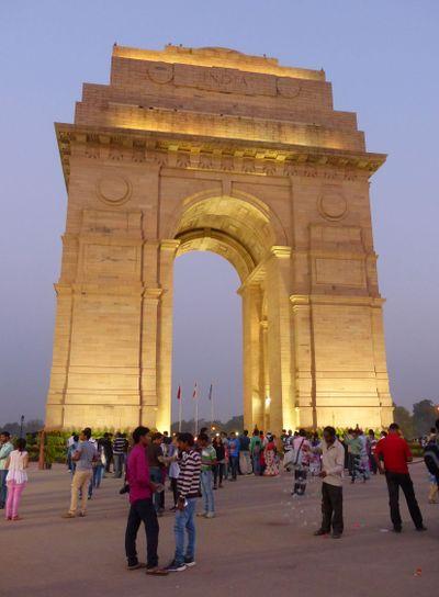 People walking around India Gate at night, New Delhi