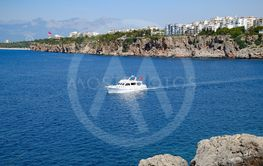 The yacht sails along the rocky coast, an excursion...