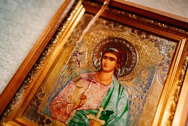 golden cross on the chain and Christian icon. Orthodox...