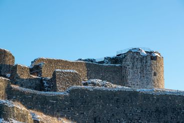 Fortress ruins against blue sky background