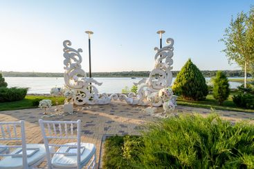 white area Wedding ceremony against of river. day.