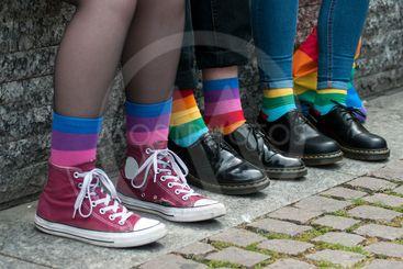 rainbow socks on lesbian girl sitting on...