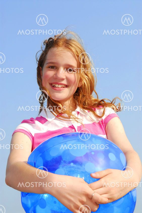 Young girl with beach ball
