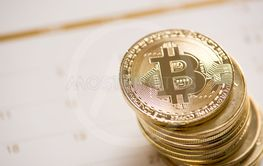 Cryptocurrency golden Bitcoin stack  on calendar, digital...