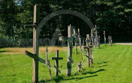 Old wooden orthodox crosses in line