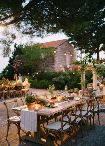 Wedding dinner table reception. A wooden table for...