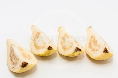 Guava fruit cut into four pieces