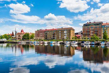 Buildings at Halmstad city in front of still river, Sweden