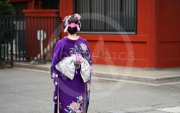 Young girl wearing Japanese kimono standing in front of...
