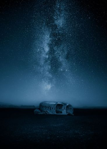 Plane wreck against milky way