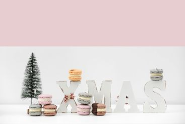 rench dessert macaroons or macarons on Christmas white...