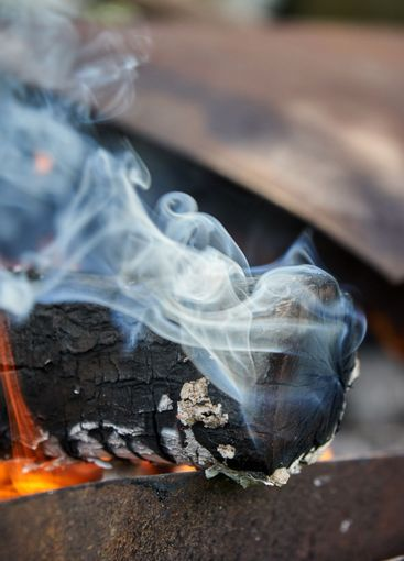 Burning logs in the grill, smoking log