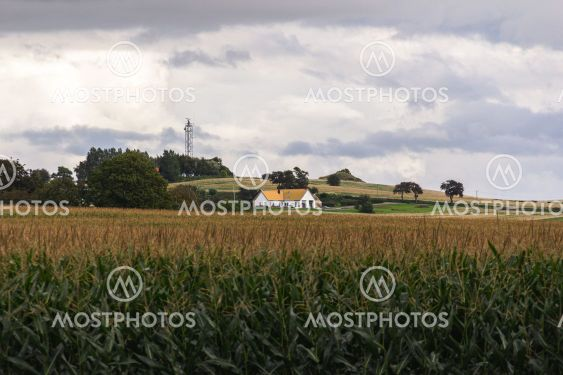 A modern home is embedded in the agricultural fields in...