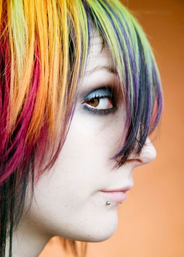 Alternative girl with multi-colred hair looks up