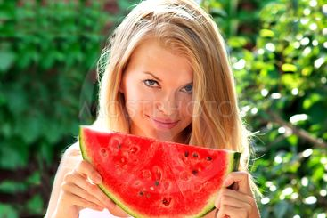 Young Woman with big slice Watermelon Berry fresh in...