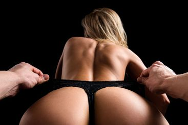Sexy couple. Sensual erotic woman stripper with big ass,...