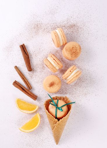 colored french dessert macarons or macaroons on a white...