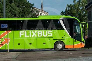 green flexbus in the street