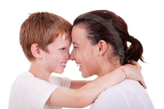 mother and son embracing cheek to cheek , isolated on...