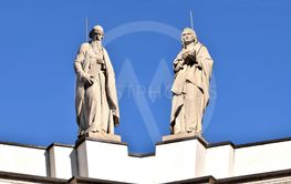 The two statues above the sky of Italy in Palazzolo in...