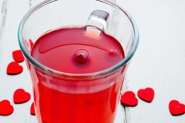 Selective focus on cranberries in a fresh drink in a...