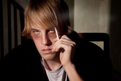 Depressed young man smoking