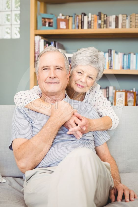 Happy romantic senior couple in living room