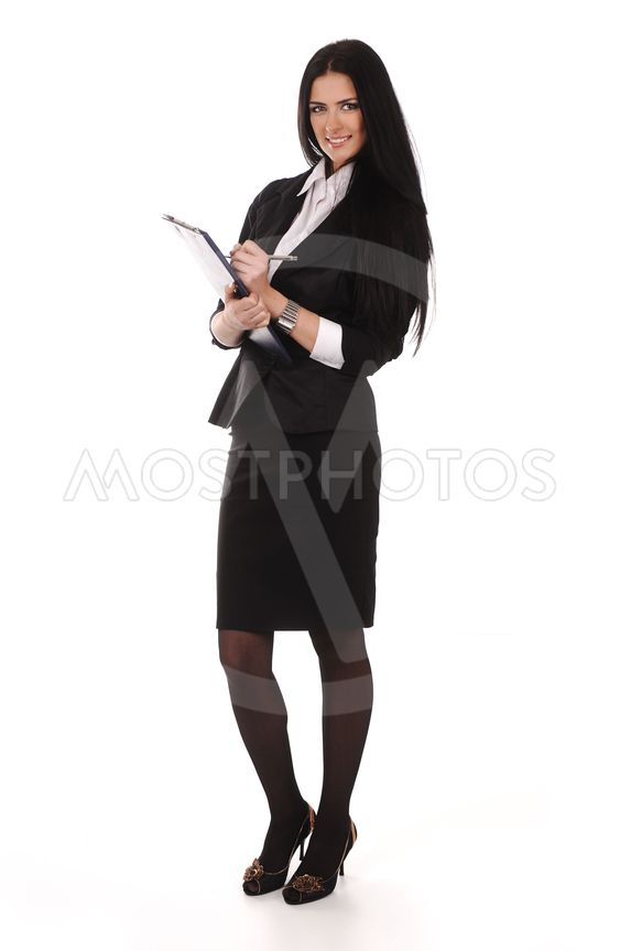 Confident young business woman standing with folder in...