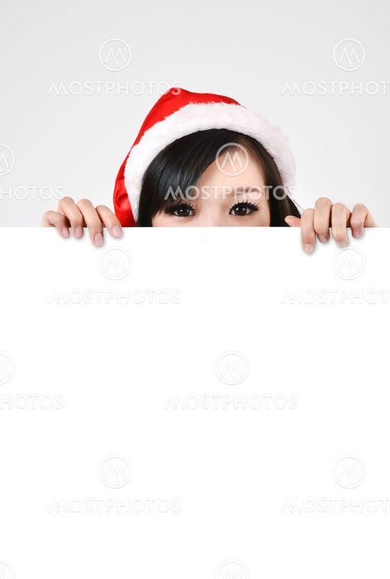 Santa woman  holding a white poster
