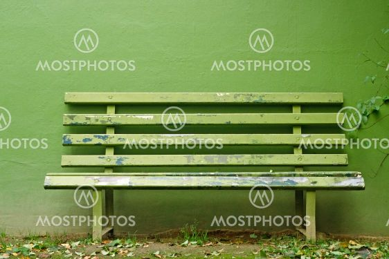 Green Bench with green wall.