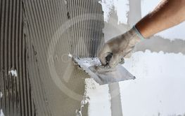 Wall insulation, spreading mortar over styrofoam,...