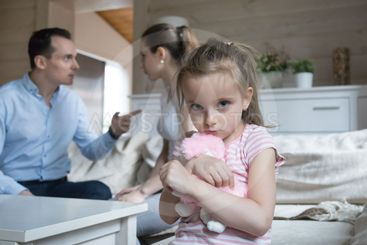 Sad little girl scared when parents have fight at home