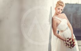 Gorgeous bride on her wedding day (color toned image;...