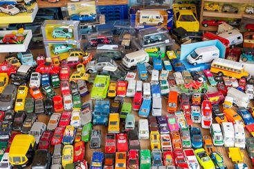 Flea market with stand selling second hand toy cars