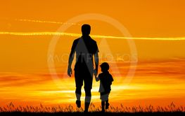 father and son walk at sunset