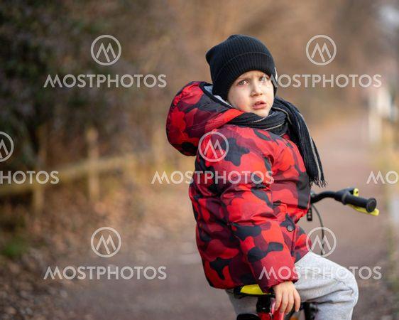 Sad kid on bicycle at park