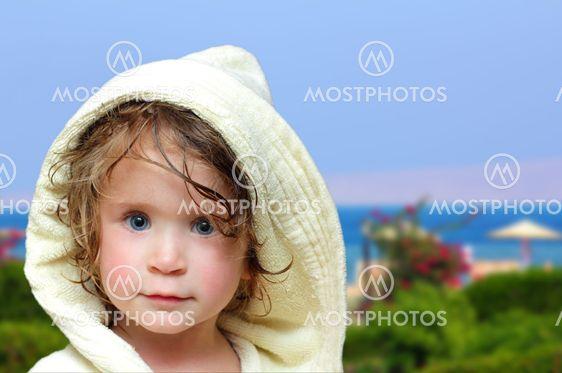 cute girl in bathrobe on beach