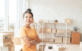 Asian Women business owner working at home with packing...