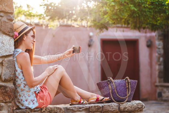 Tourist woman taking travel selfie photos with smartphone...