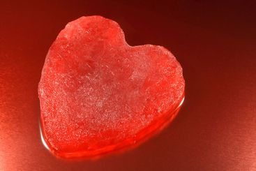 Melting red ice heart.