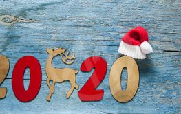 New year concept. Digits 2020 on wooden background with...